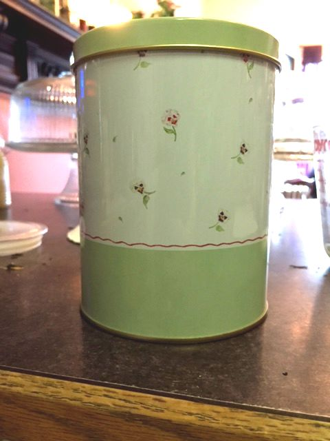 tin with floral pattern