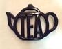 navy or black teapot holder or coaster