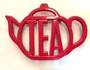 red teapot holder or coaster